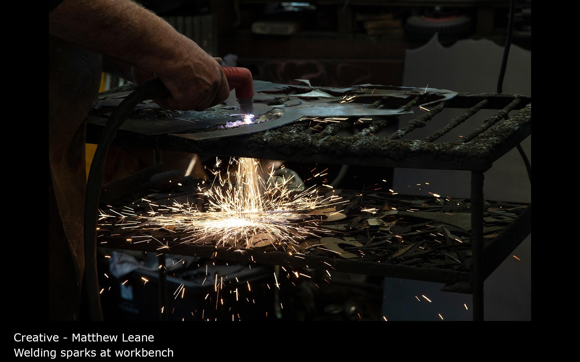 Welding sparks at workbench - Matthew Leane